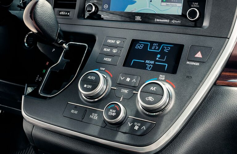 Control knobs and gear shifter inside Toyota Sienna