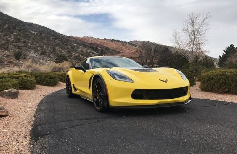 yellow 2016 Chevrolet Corvette parked in desert