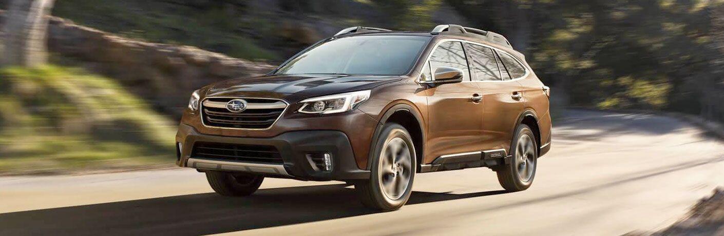 2020 Subaru Outback cruising on a road