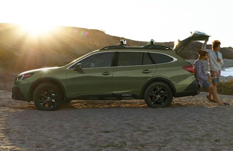 2020 Subaru Outback with people hanging out at the trunk