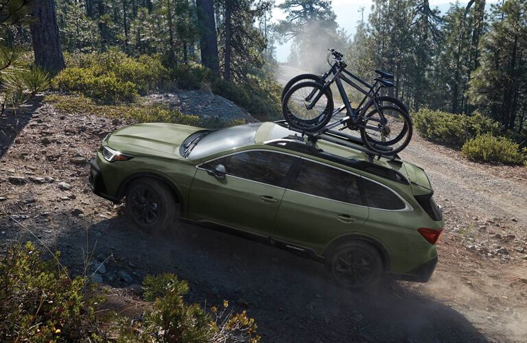 2020 Subaru Outback climbing a rocky trail