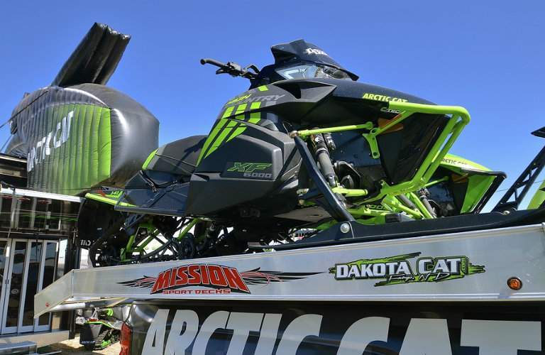 Arctic Cat snowmobile parked in trailer bed