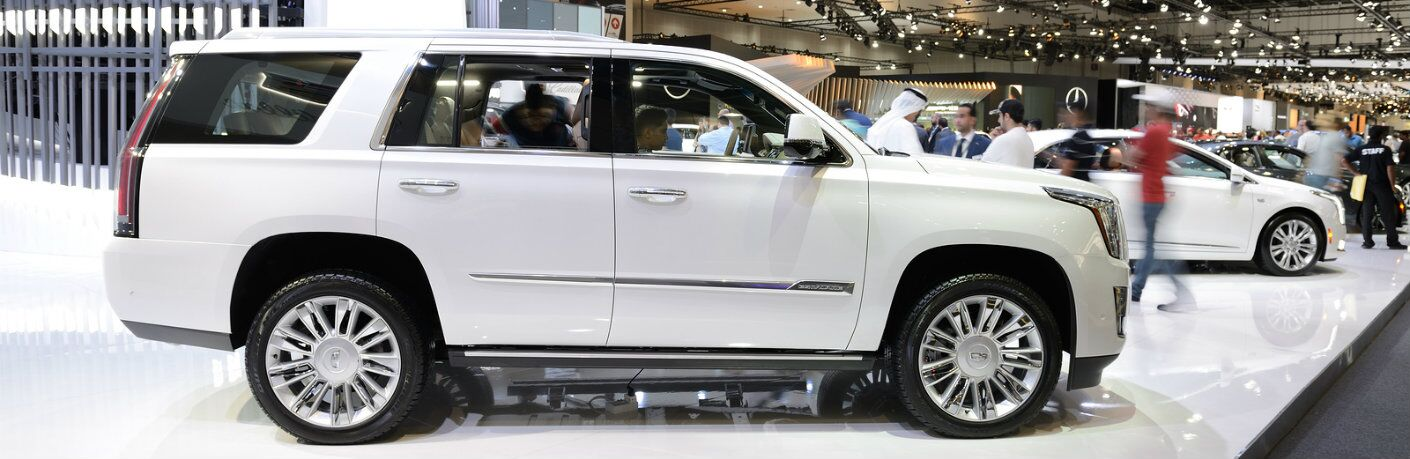 Profile view of white Cadillac Escalade at Dubai Auto Show