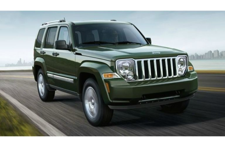 2012 Jeep Liberty driving out of a city
