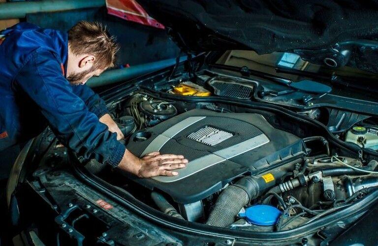 Mechanic working under hood