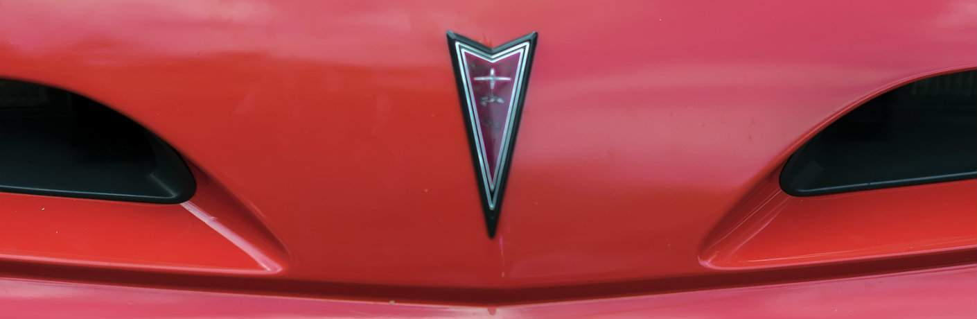 Closeup shot of Pontiac emblem on vehicle