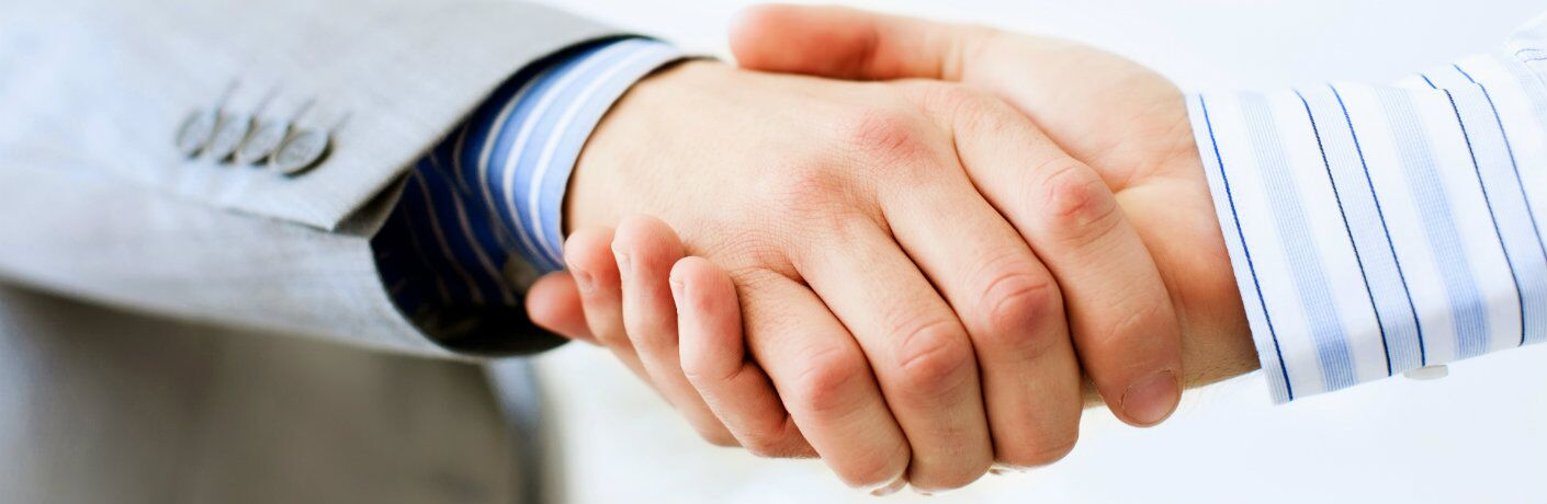 Close-up view of two men shaking hands
