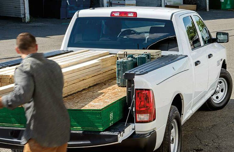 Man hauling lumber with Ram truck