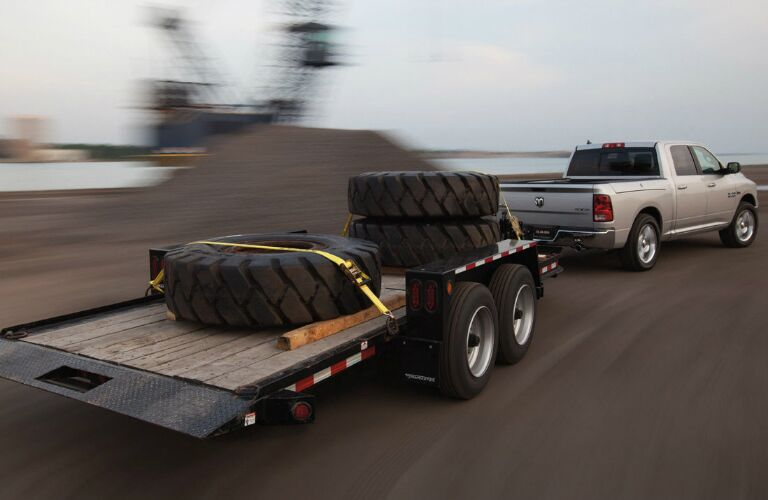 Ram truck pulling trailer with tires on it