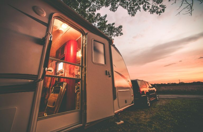 Motorhome parked under the sunset