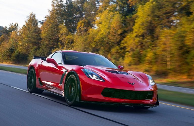 red_2016_Chevy_Corvette_Z06_speeding_past_trees