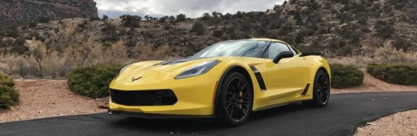 yellow 2016 Chevrolet Corvette in desert