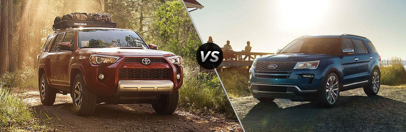 2018 Toyota 4Runner and 2018 Ford Explorer facing each other while parked on dirt paths in comparison shot