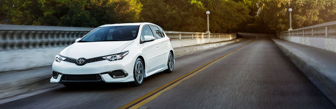 White 2018 Toyota Corolla iM driving across a bridge