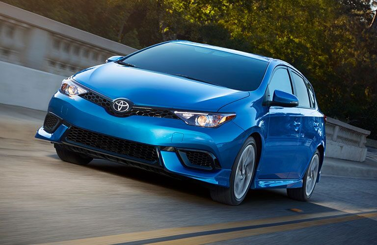 Blue 2018 Toyota Corolla iM driving on the road during the day