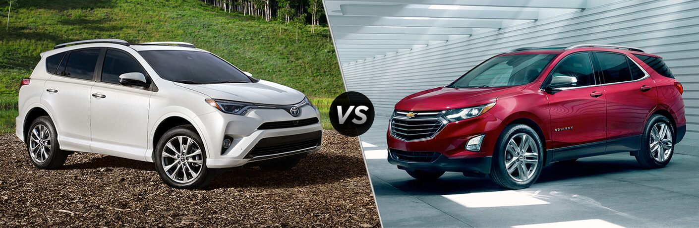 White Toyota RAV4 and red Chevrolet Equinox facing each other