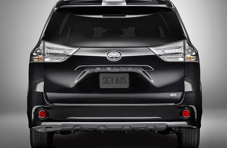 Rear shot of black 2018 Toyota Sienna with name badge and bumper visible