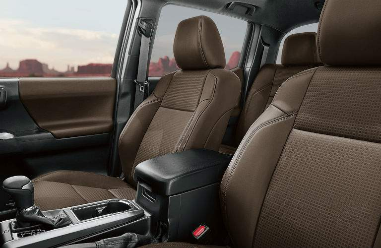 Front two seats of 2018 Toyota Tacoma with prominent gear shifter