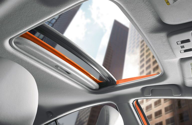 Moonroof open to a skyscraper on top the 2018 Toyota Prius c