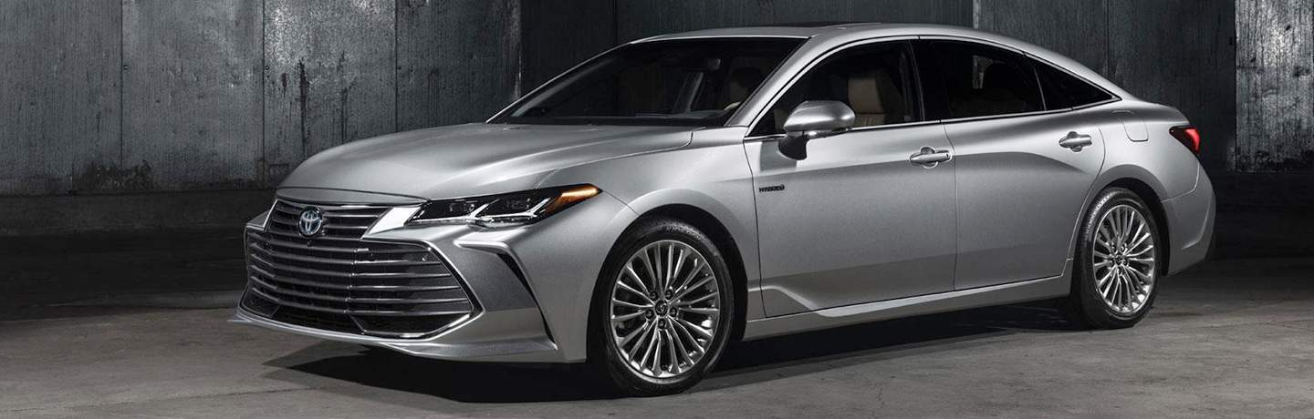 Long view of silver 2019 Toyota Avalon parked in warehouse