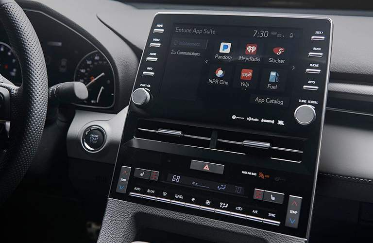 Touchscreen interface of 2019 Toyota Avalon with steering wheel in frame