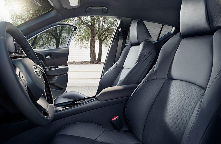 Door open to reveal two seats inside 2019 Toyota C-HR