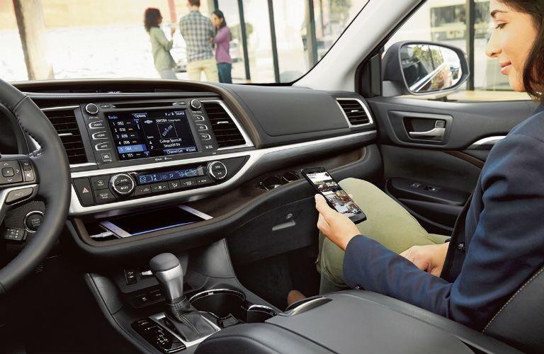 Woman using phone inside 2019 Toyota Highlander