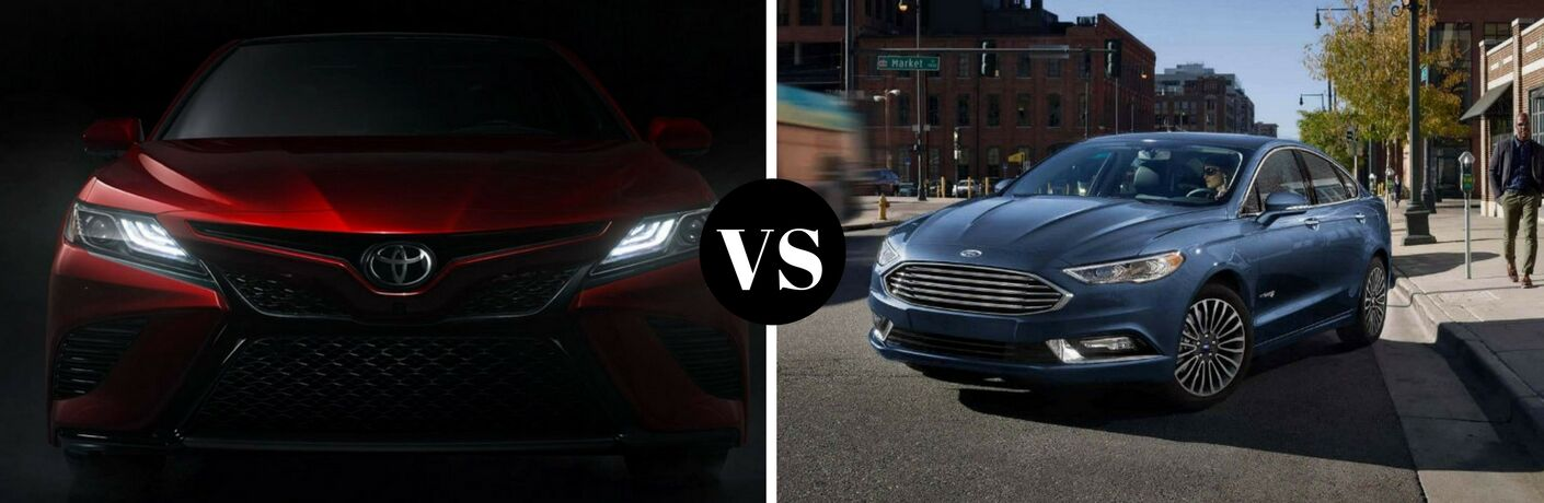 Left side a red 2018 Toyota Camry in the dark, on the right a blue 2018 Ford Fusion parked