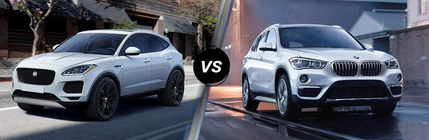 White 2018 Jaguar E-PACE on City Street vs White 2018 BMW X1 on Street at Night