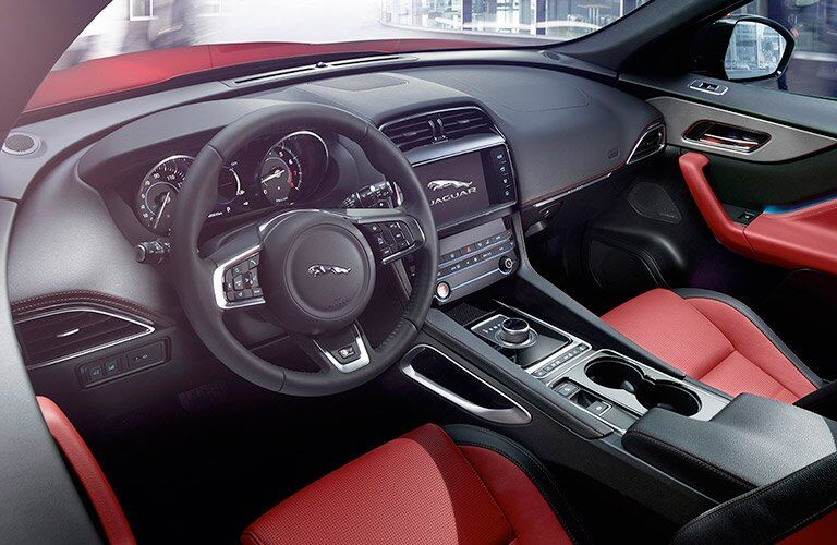 Red and Black 2018 Jaguar F-PACE Front Seat Interior with Steering Wheel and Touchscreen Display