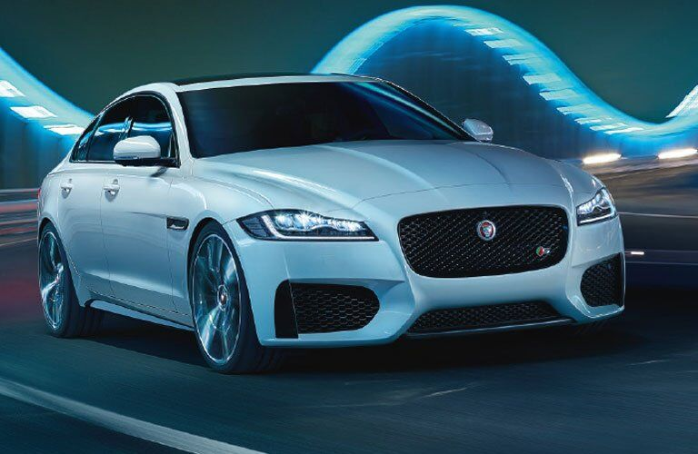White 2018 Jaguar XF Front and Side Exterior at Night