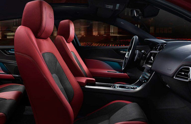 Side View of Red and Black 2018 Jaguar XE Front Seats and Dashboard