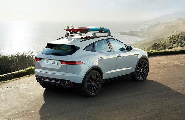 White 2018 Jaguar E-PACE with Surfboards on Roof on Ocean Overlook