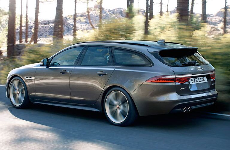 Gray 2019 Jaguar XF Sportbrake Rear Exterior on a Country Road