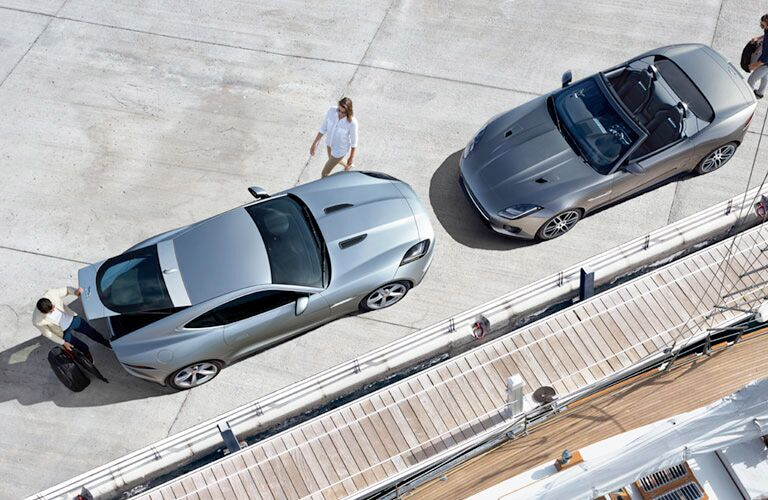 Overhead View of Silver 2019 Jaguar F-TYPE Coupe and Silver 2019 Jaguar F-TYPE Convertible at a Marina