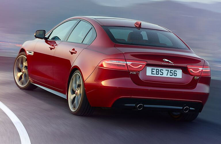 Red 2019 Jaguar XE Rear Exterior on a Freeway