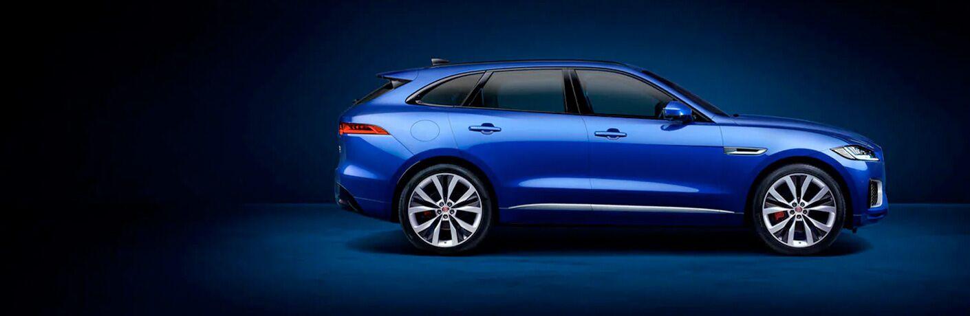 Blue 2020 Jaguar F-PACE Side Exterior on a Dark Blue Background