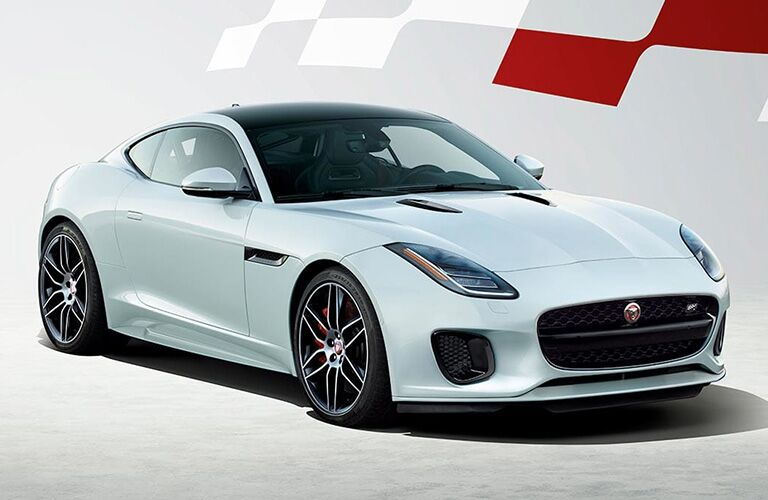 White and Black 2020 Jaguar F-TYPE Checkered Flag Limited Edition on White Background with a White and Red Checkered Flag