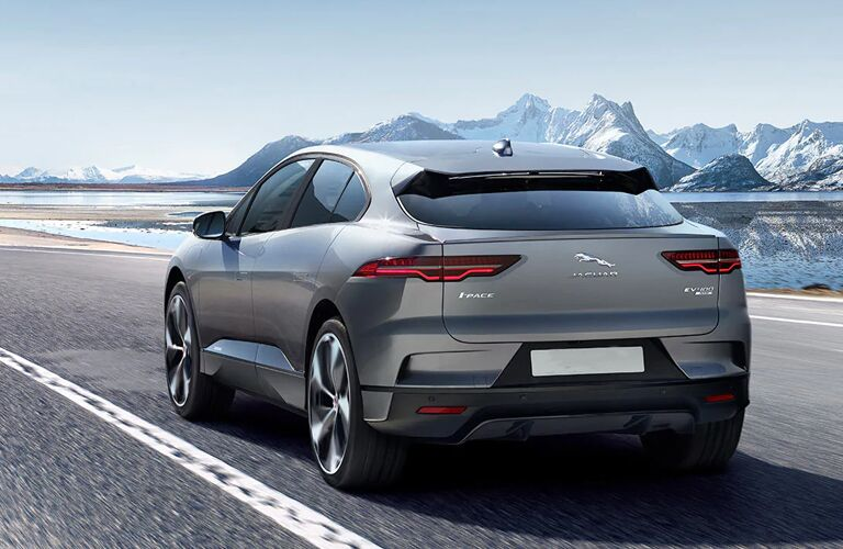 2020 Jaguar I-PACE driving away with mountain in background