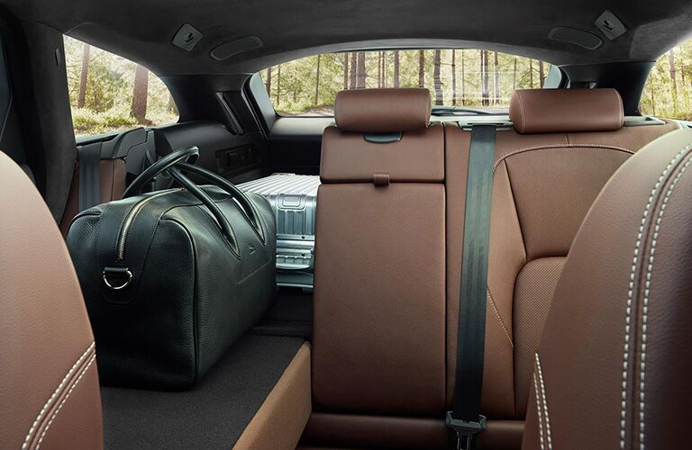 Interior of 2020 Jaguar XF with luggage in the back and seat folded down