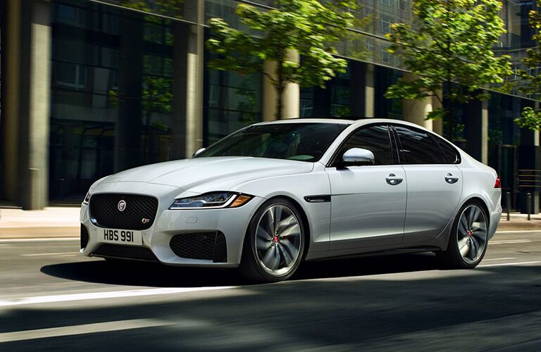 White 2020 Jaguar XF Front Exterior on a City Street