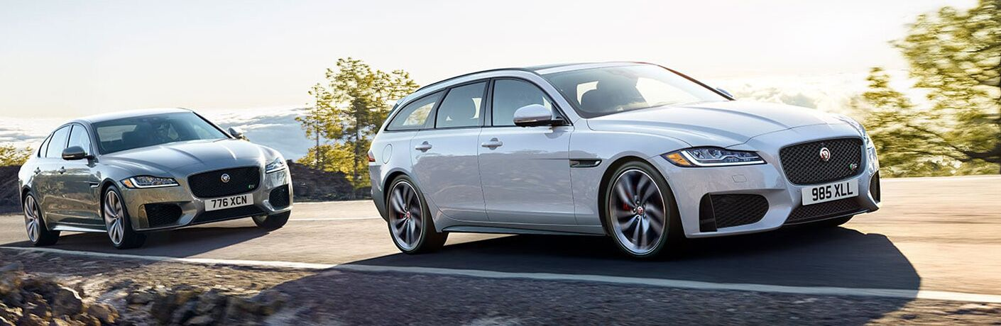 White 2020 Jaguar XF Sportbrake and a Silver 2020 Jaguar XF on a Mountain Road