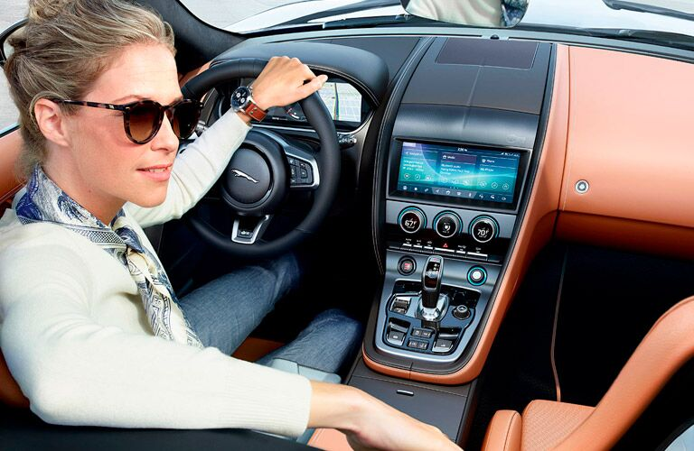 Woman behind the wheel of a 2022 Jaguar F-TYPE