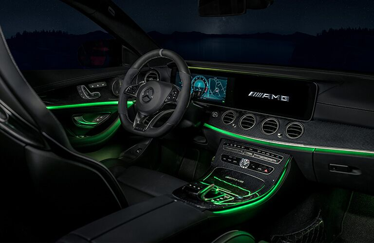 2019 MB AMG E 63 S interior front cabin steering wheel and dashboard with green mood lights