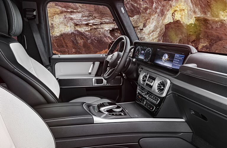 2019 Mercedes-Benz G-Class interior front cabin side view seats steering wheel and dashboard