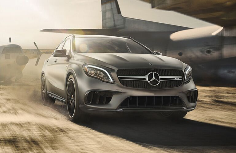 2019 MB GLA exterior front fascia and passenger side going fast near airplanes