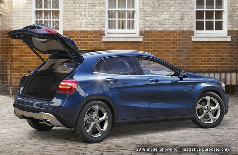 2019 MB GLA exterior back fascia with trunk open and passenger side in front of brick building
