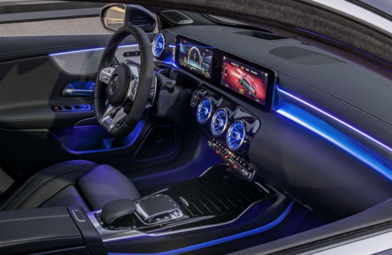 2020 MB AMG A-Class interior front cabin steering wheel touchscreen and dashboard with blue ambient lights