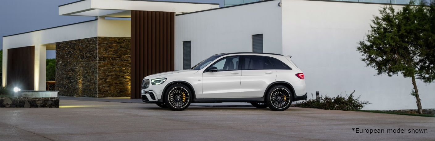 2020 MB AMG GLC exterior driver side in front of white building