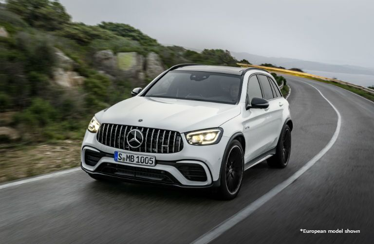 2020 MB AMG GLC exterior front fascia and driver side going fast on hill highway